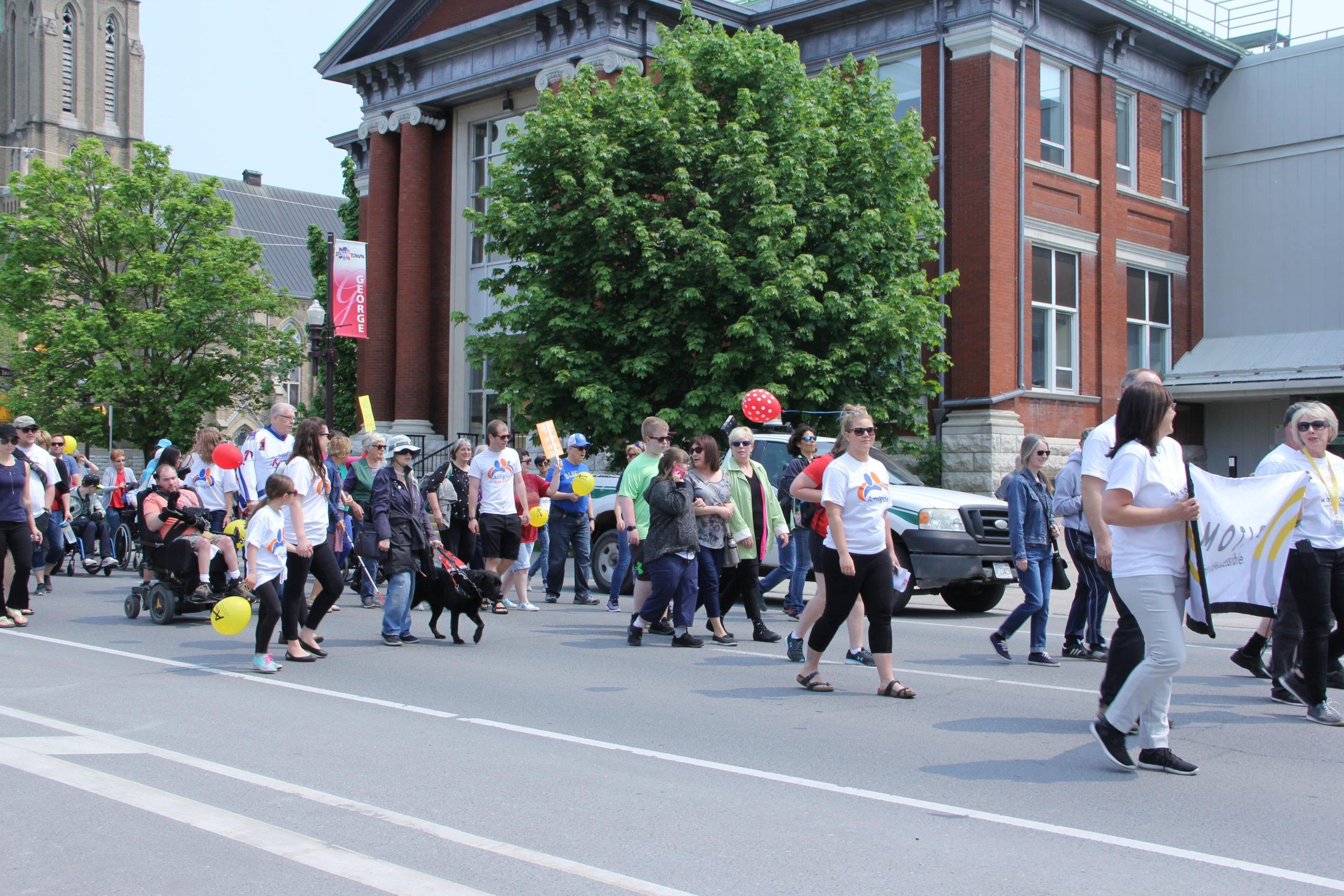 Various individuals walking down George Street in Peterborough for the first Annual Abilities and Inclusion Movement