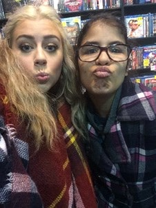 """two young women pose for a """"duckface"""" selfie"""
