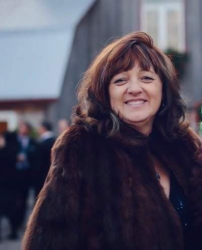 Woman with brown hair smiling for a photo