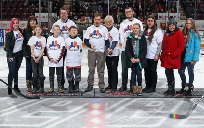 Amigos and Board members on the ice with Petes Hockey