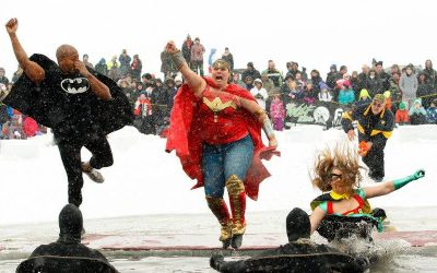 Batman, Superwoman and another superhero plunge into the cold lake for a polar plunge event